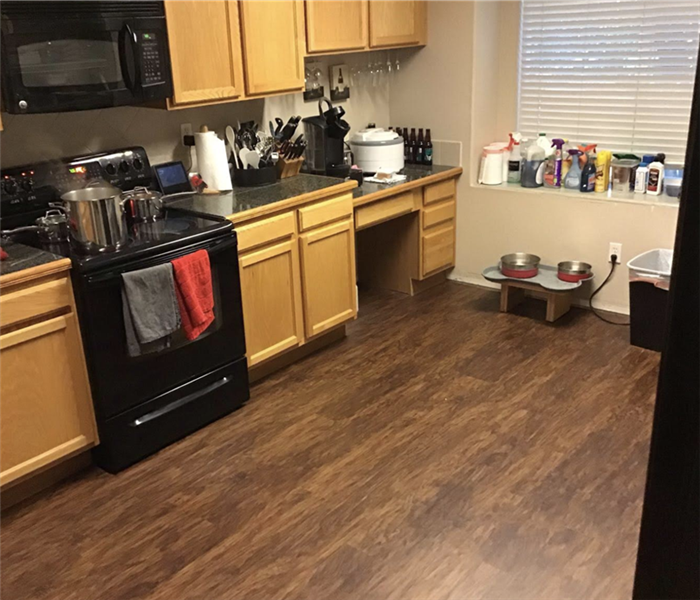 a kitchen with brown vinyl flooring