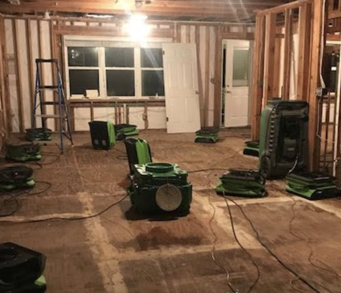 an empty room with green drying equipment