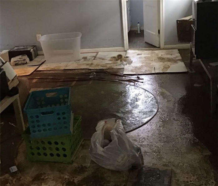 a room with mud and water on the ground