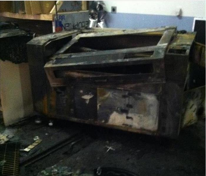 Printer severely damaged by a fire.